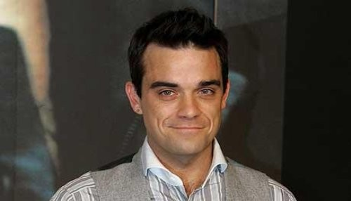 Robbie Williams: Harry Styles es un imán para las chicas