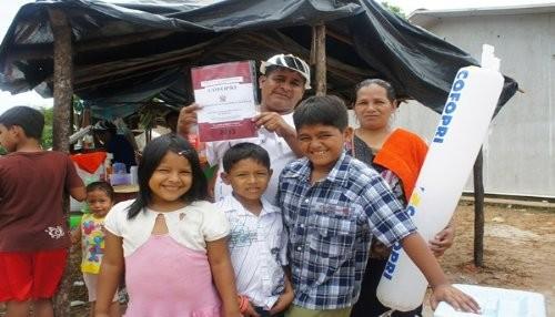 Entregan títulos a familias de Belén afectadas por incendio de diciembre 2012