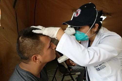 San Juan de Lurigancho: Brigada del INO atiende gratuitamente a pobladores afectados por aniego