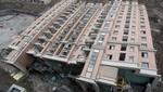 China: Cae edificio de 13 pisos y queda intacto (Fotos)